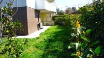 LAURENTINA CASTEL DI LEVA – Splendido appartamento rifinito con ampio giardino e posto auto